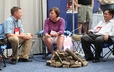 Brian Frick, Lauren Mathews, and David Loleng enjoy a moment in the Exhibit Hall.