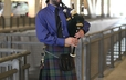 Evan Kenepp, one of several bagpipers from the Pittsburgh area, who played outside the convention center throughout the day.