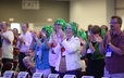 "Some of the crowd of supporters who donned ""Bolbach green"" wigs in support of 219th GA Moderator Cindy Bolbach and all cancer survivors."