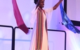 A liturgical dancer from All God's Children Liturgical Dancers performs during opening worship at the 220th GA.