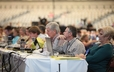 Commissioners to the 220th General Assembly listen during the afternoon business session on Saturday.