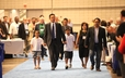 Newly elected Moderator of the 220th General Assembly, the Rev. Neal D. Presa, walks to the platform with his family and former GA Moderator, the Rev. Bruce Reyes Chow.
