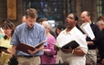 "Joyful voices are raised in song at the ""Glory to God"" Hymn Festival at First Presbyterian Church, Pittsburgh, during the 220th General Assembly."
