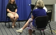 Blair Buckley, of the Young Adult Volunteer program, is videotaped for the Faith Sharing Project, sponsored by the offices of Vocation, Evangelism, Church Growth and Theology, Worship and Education du