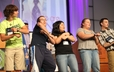 220th GA young adult advisory delegates lead an energizer on Thursday night.