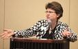 The Rev. Anne D. McKee, campus minister at Maryville College (Tenn.), address MC breakfast gathering at GA 220.
