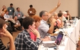 Members of the GA 220 Middle East Peacemaking Issues Committee in session on Monday.