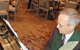 David Eicher, editor of Glory to God: The Presbyterian Hymnal, plays piano as participants at the Presbyterian Publishing Corporation Breakfast sing from the hymnal sampler at GA 220.