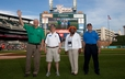Members of the Committee on Local Arrangements take to the field at Comerica Park for the Detroit Tigers game.