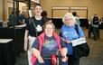 (From left to right) Cynthia Walton-Leavitt, Peg Howland, and Kathy Conner are registered and ready to start the Assembly.