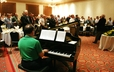 Attendees worship with music at the PFR/Fellowship of Presbyterians Breakfast.