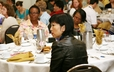 Attendees of the Educate a Child, Transform the World luncheon hear presentations.