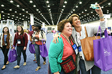 Terri Summers Minette (left) and Laura Walters (right) stop for a quick exhibit hall selfie like so many friends that reconnect at Asemblies. - by Danny Bolin