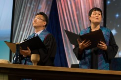 Worship leaders address plenary during closing worship