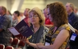 "Worshipers use a sampler edition of ""Glory to God,"" the new Presbyterian hymnal that will be published in 2013."