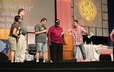 "Members of Hot Metal Bridge enact the ""Welcome Mat"" skit during Friday's worship service at the 220th GA."