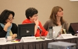 Members of the GA 220 Church Polity Committee leadership team--Eunkiung Hahm, Emily Anderson, and Rebecca Kirkpatrick--at work on Monday.