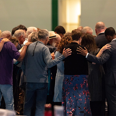 image of people in prayer circle